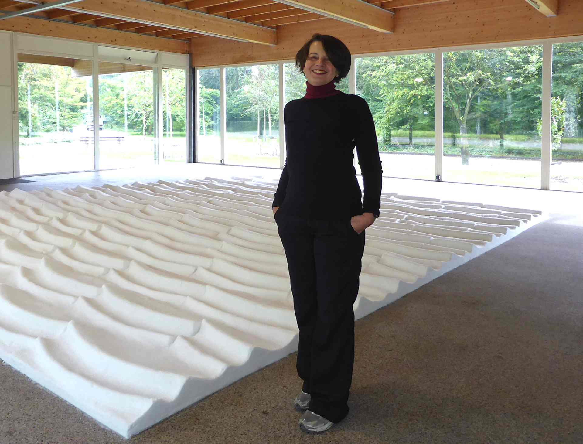 The artist in front of Salina - ephemeral art installation made of salt